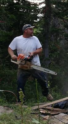 Aaron Cutting down the threatening tree.